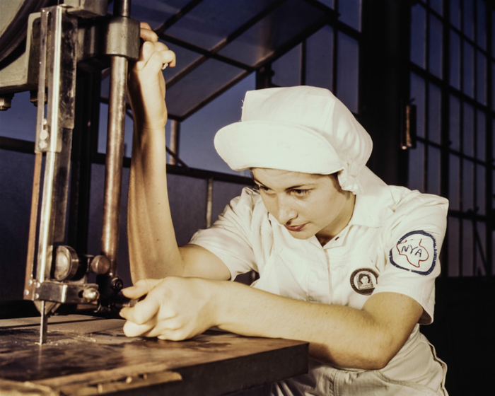 Color toned vintage photography of a female factory worker