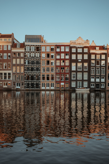 View of buildings by the canal at Damrak
