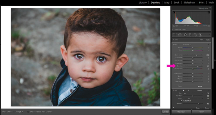 Editing a portrait of a little boy using a Brush with Clarity +57 and Exposure +1.70