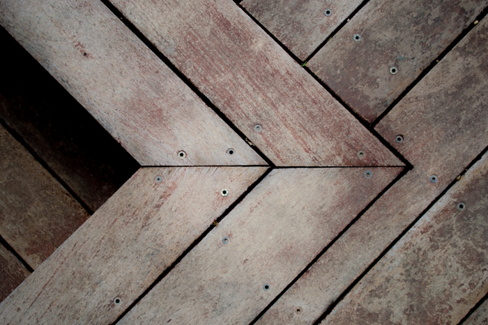 a photo of wooden floorboards with decreased clarity to blur the wood texture - clarity tool lightroom