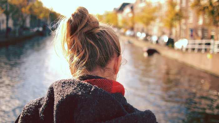 a portrait of a girl by a river