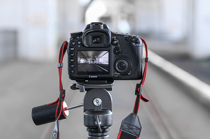 A DSLR camera mounted on a tripod to shoot levitation photography
