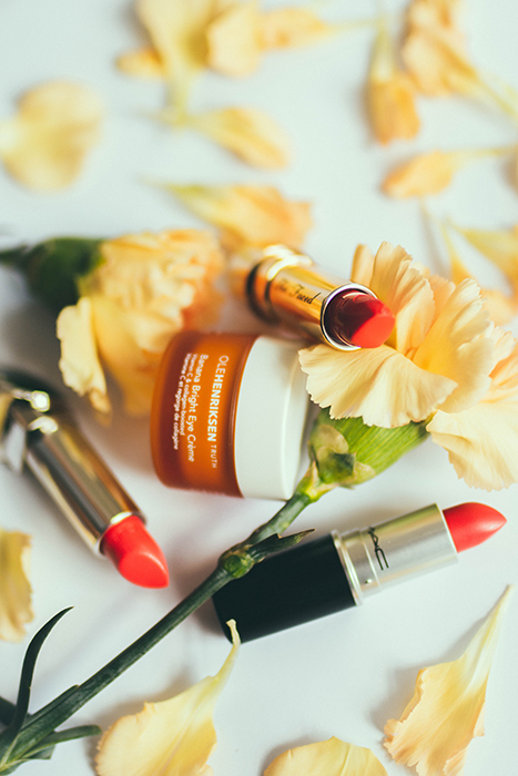 A floral themed cosmetic product photography shot - makeup photography tips