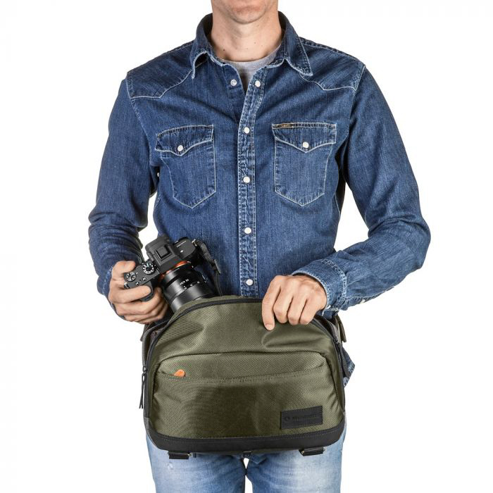 A male model with a DSLR and a Manfrotto Lifestyle Street CSC Waistpack