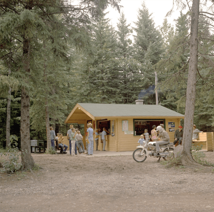 An old photo of a cabin in the woods - how to restore old photographs