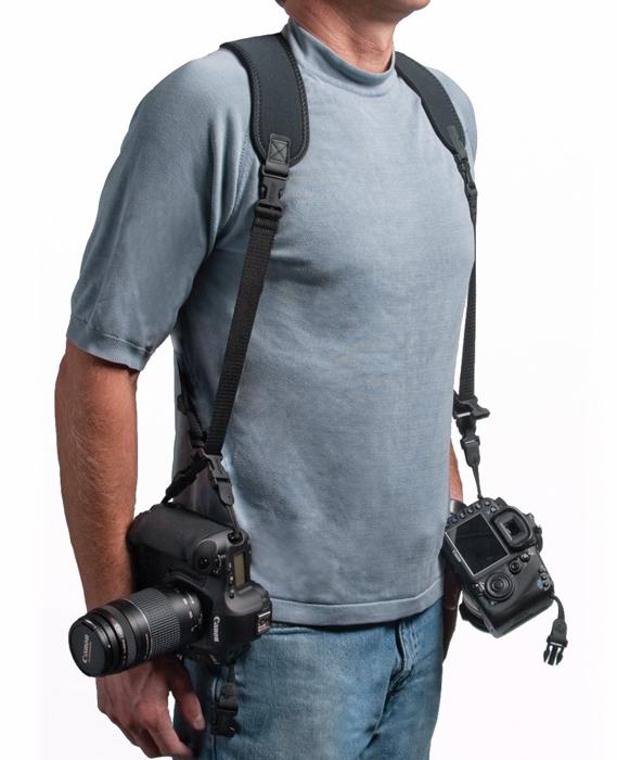 A photographer wearing the OP/TECH USA Double Sling