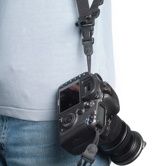 A photographer wearing a OP/TECH USA Double Sling