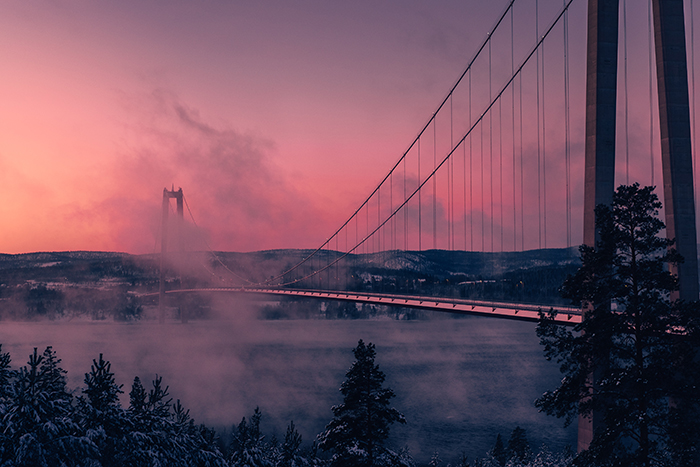 Artistic shot of a bridge in the colored light of sunset