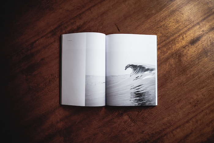 A minimalist photo book opened on a wooden table