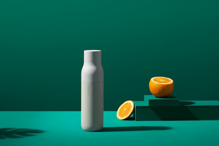 minimal product shot on green background - best lens for product photography