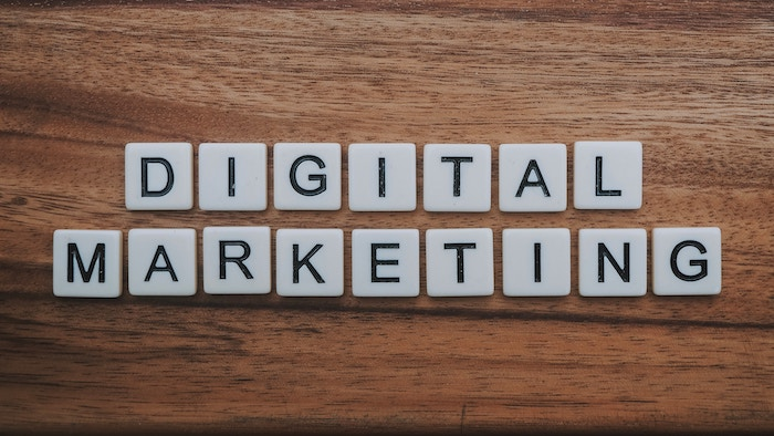 scrabble pieces spelling 'Digital Marketing' on a wooden table - seo for photography tips