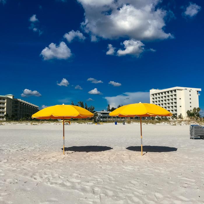 yellow sun umbrellas on a sandy beach - smartphone landscape photos