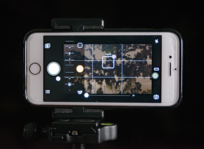 a smartphone set up on tripod to shoot landscape photos