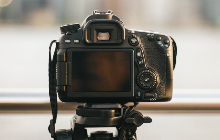 a DSLR camera on a tripod - shutterbands review