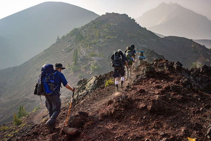 a group of hikers on a mountain trail