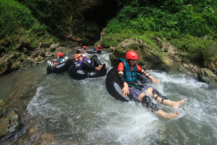 a group of adventurers tube rafting