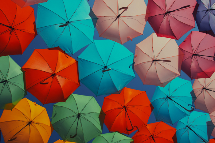 many umbrellas in different bright colors