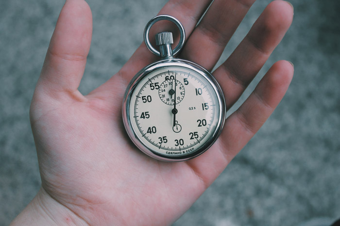 a pocket watch in a persons hand - symbolism in photography