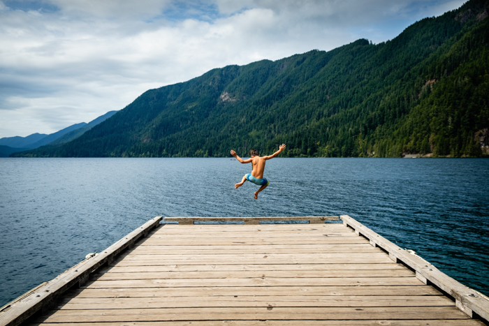 cool portrait of a man jumping from a wooden pier - focus breathing tips