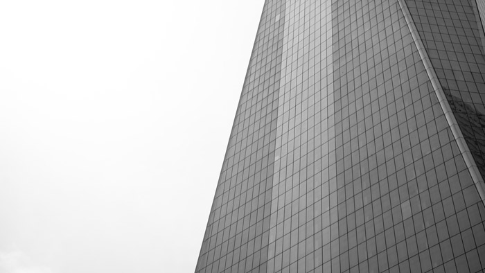 Detail of a multi windowed glass building demonstrating geometric photography