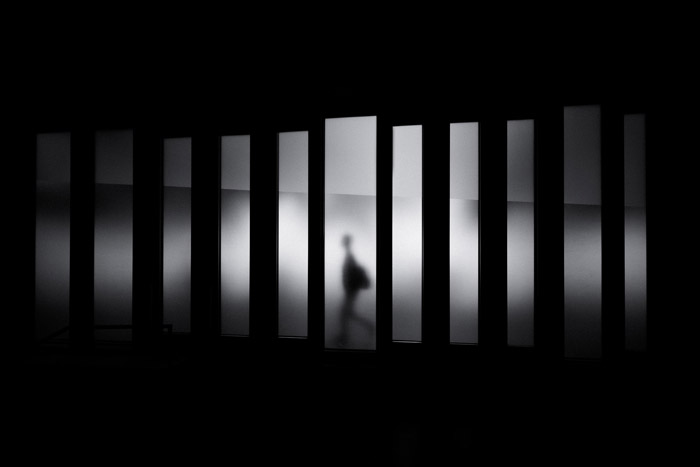 atmospheric photo of the silhouette of a person walking through lines demonstrating geometric photography
