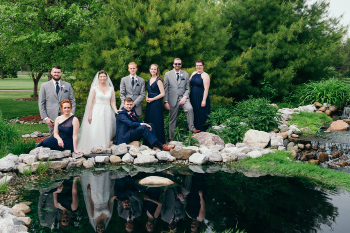 a group shot of the wedding party at an outdoor wedding photography shoot