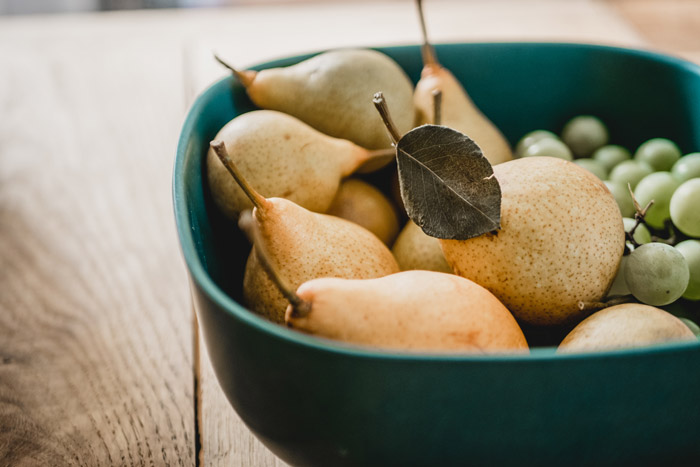 a bowl of pears and grapes - symbolism in photography