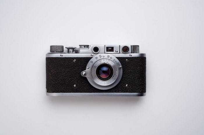a vintage camera on white background