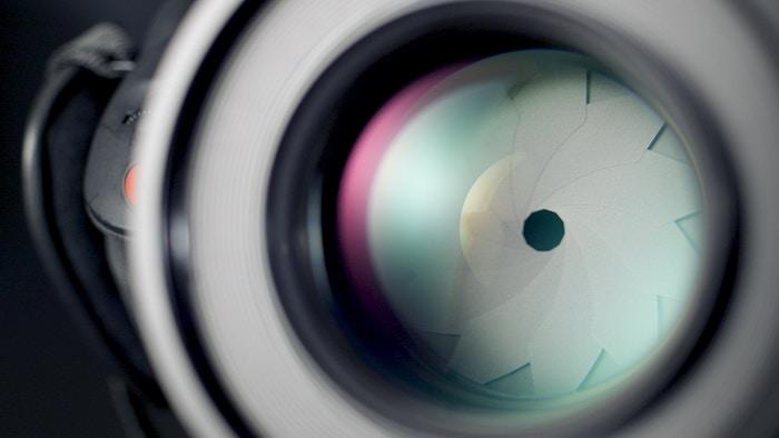 close up of a camera aperture - prime lens tips