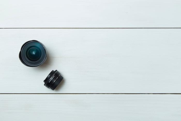 overhead shot of two prime lenses on white boards