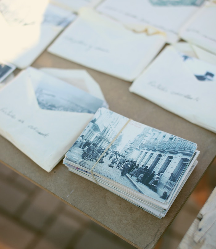 a table of printed vintage photographs