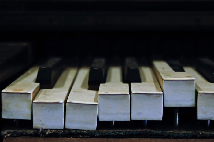 close up of piano keys - symbolism in photography
