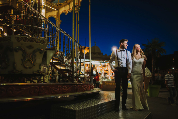 portrait of a couple at the fairground at night shot with the Profoto b10 flash