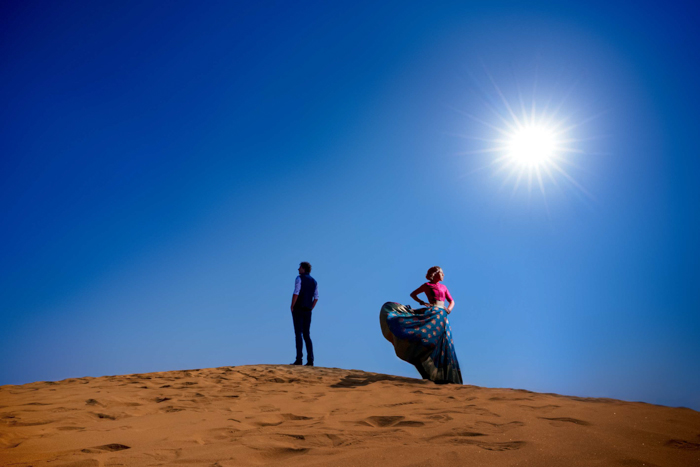 a stunning portrait of a couple posing in a desert shot with the Profoto b10 flash