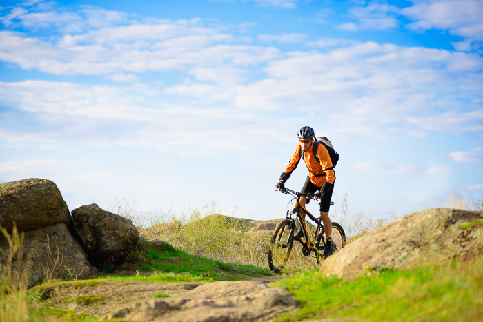 outdoor portarit of a cyclist moving through a landscape - blurry photos