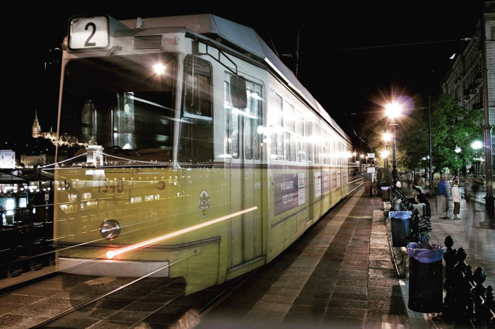 long exposure of a tram moving at night - best photography spots in Budapest
