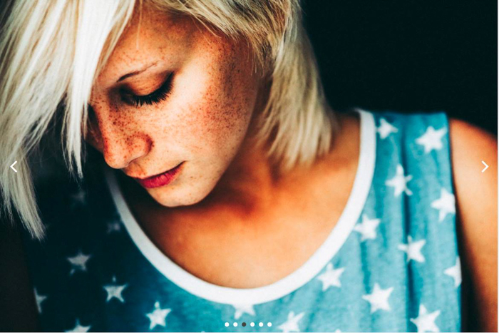 Close-up portrait of a woman with freckles in a star-patterned vest luc besson preset