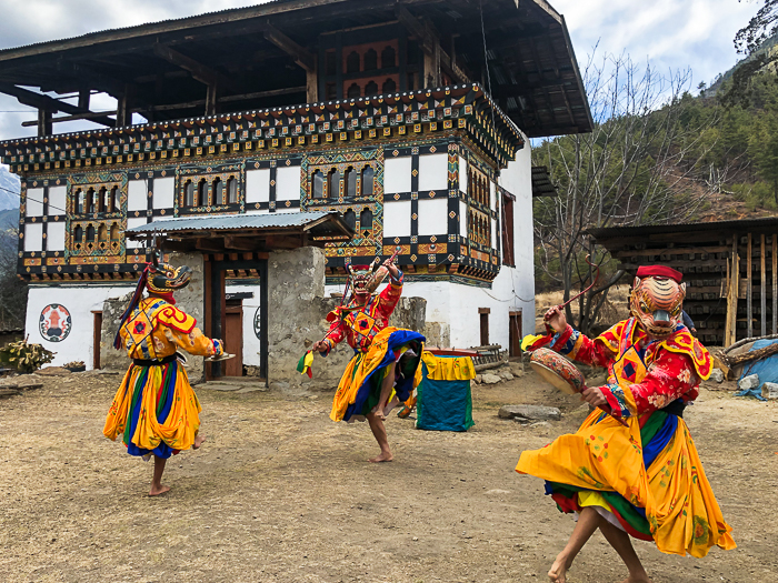 A freeze motion photography shot of traditional dancers in costume