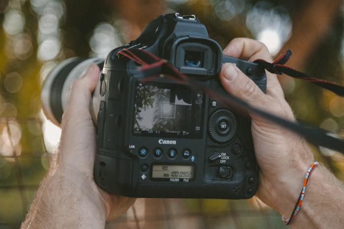a photographer shooting through a Canon full frame DSLR