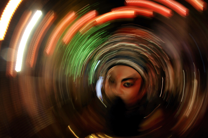 Artistic spiral blur of intentional camera movement around a persons face