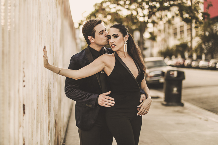 Photo of a couple posing on a street