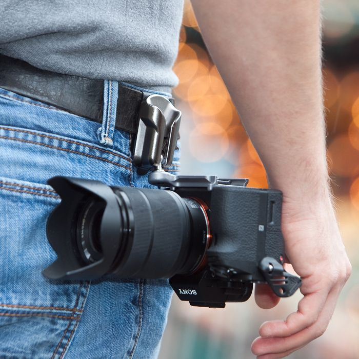 Close up of a Sony DSLR attached to the SpiderLight Backpacker Bag Holster
