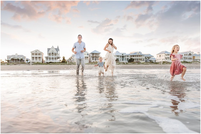 Photo of a family running on the beach by Chubby Cheek Photography