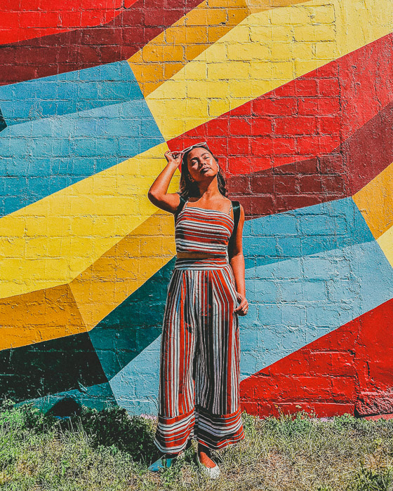 Colourful photo of a girl with different angles on a brick wall in the background