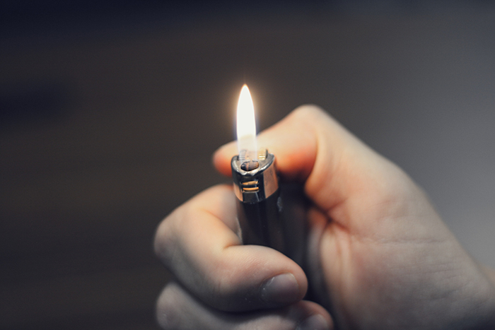 Close-up photo of a hand holding a lighter