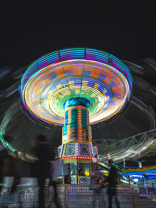 Motion blur photo of a ride at an amusement park