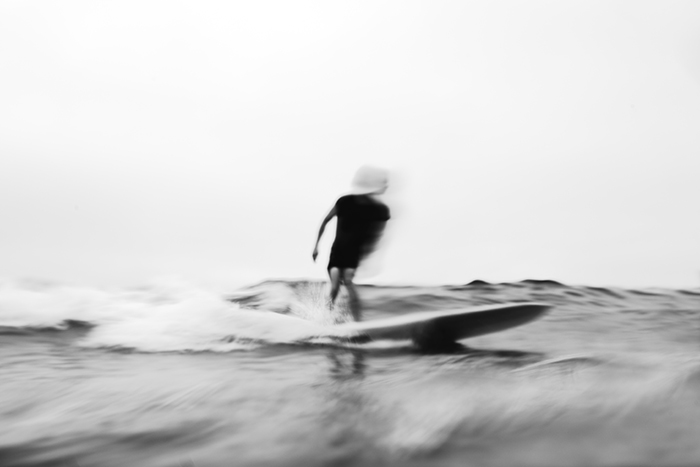 Motion blur photo of a man surfing
