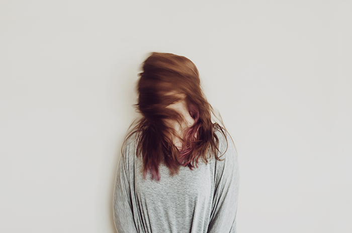 Motion blur photo of a woman shaking her hair
