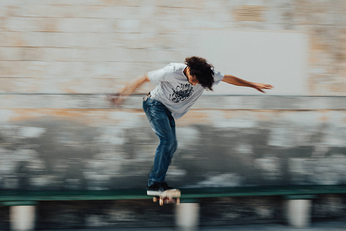 Motion blur photo of a man skateboarding