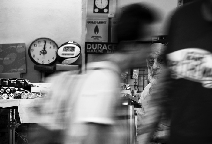 Motion blur photo of people at a shop